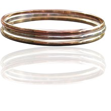 Set of three gold filled bangles in rose gold, yellow gold and white gold