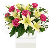 Lilies and Roses, Arrangements From $65
