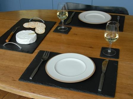 Slate placemats pair heaven in earth for Soapstone dining table