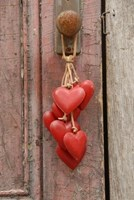 Hanging Red Hearts on Leather